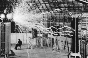 Nikola Tesla sitting with his coil at Colorado Springs (double exposure image)